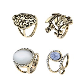 Stone Inlaid Hollow Retro Alloy Ring