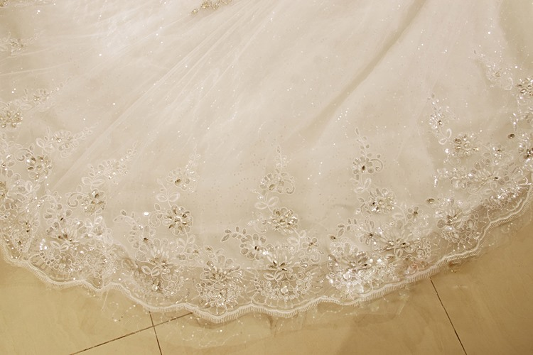 Luxurious Beading Ball Gown Cathedral Train Wedding Dress